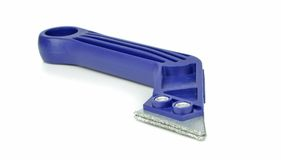 Grouting Scraper Tool. A grout rake scraper tool for removing tile grouting Royalty Free Stock Images