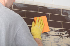 Grouting ceramic tiles Stock Image