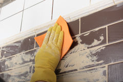 Grouting ceramic tiles Royalty Free Stock Image