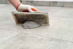 Grouting ceramic tiles. Stock Photography