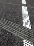 Grouting and hot plastic stripe on asphalt_3. White hot platic stripe on asphalt road stock photography