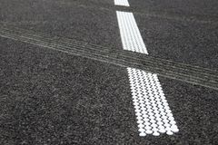 Grouting and hot plastic stripe on asphalt_4. White hot platic stripe on asphalt road royalty free stock photography
