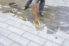 Grouting tiles on the floor Stock Photography