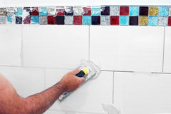 Grouting tiles Royalty Free Stock Image