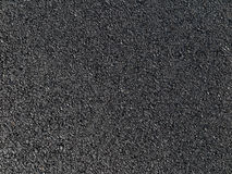 Grov asfaltbeläggningtextur arkivbild