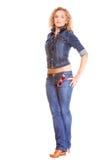 Grov bomullstvillmode. Blond flicka för full längd i jeans Royaltyfria Bilder
