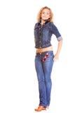 Grov bomullstvillmode. blond flicka i jeans Royaltyfri Fotografi