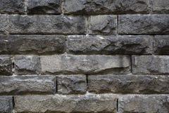 Grov granitstenvägg Arkivfoto