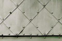 Grov industriell bakgrund med gräns texturerade metallisk yttersida Royaltyfria Foton