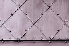 Grov industriell bakgrund med gräns texturerade metallisk yttersida Royaltyfri Bild