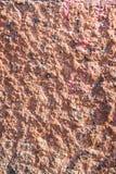 Grov kapitalvara texturerad stuckaturväggbeläggning Abstrakt patchy bakgrund Arkivfoton