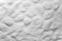 Grov ojämn vit målad textur för stenvägg fotografering för bildbyråer