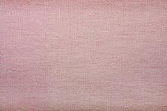 Grov textur av ett rosa textilmaterial Royaltyfria Foton