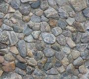 Grov textur av stenväggen bakgrund föder upp den steniga stenstrukturen för rocken Royaltyfri Bild