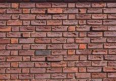 Grov vägg för röd tegelsten Arkivfoton