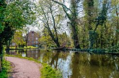 The Grove Mill in Watford. The Grove Mill and the old Mill House in Cassiobury Park, in Watford, Hertfordshire, England on a sunny April`s morning royalty free stock images