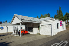 Groveland, California - United States - July 22, 2014: A classic red Volkswagen Beetle sits parked at an abandoned gas station. stock photo