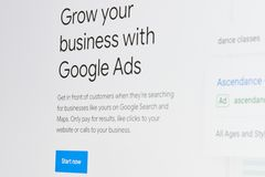 Grow business with google ads. New york, USA - april 8, 2019: Grow business with google ads on digital screen macro close up view stock photo