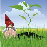 Grow grow grow grow faster. Lovely garden gnome, welcoming the spring season Stock Image