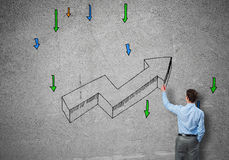 Grow and success concept. Rear view of businessman drawing increasing graph Royalty Free Stock Photo