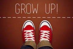 Grow Up Reminder for Young Person, Top View. Grow Up Reminder for Young Person in Red Sneakers about to make a Step and Join the Party, Top View Royalty Free Stock Photography