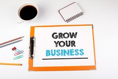 Grow your business concept.  Office desk with stationery Royalty Free Stock Image