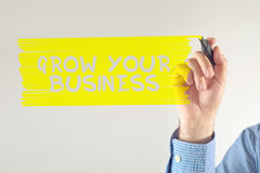 Grow your business. Message written by businessman Royalty Free Stock Photo