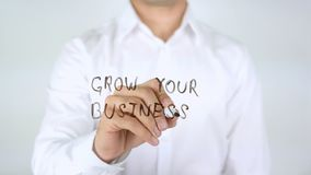 Grow Your Business, Writing on Glass. High quality royalty free stock photos