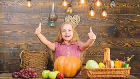Grow your own organic food. Kid farmer with harvest wooden background. Harvest festival concept. Child little girl enjoy. Farm life. Organic gardening. Girl kid royalty free stock images