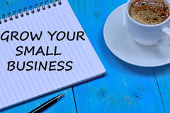 Grow your small business words on notebook Stock Image
