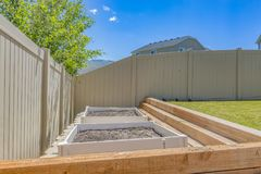 Empty growbeds in clean backyard with lawn stock photos