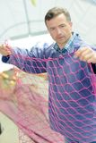Grower sorting out net. Grower Royalty Free Stock Images