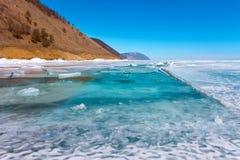 Growers ice iceberg in turquoise water of Lake Baikal Royalty Free Stock Photos