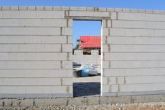 In the growing area. Construction of a house,  bricklaying Stock Photos