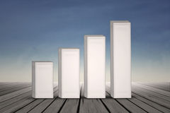 Growing bar chart on blue sky background Royalty Free Stock Photo