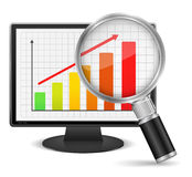 Growing Bar Graph. Magnifying glass showing growing bar graph on the screen of computer monitor Royalty Free Stock Images