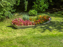 Growing Boat. Old rowing boat being used as a flower bed Stock Photo