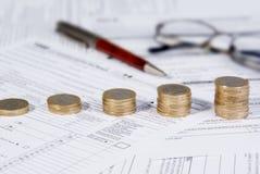 Growing coin stack. Saving money concept - Growing savings. Growing coin stack Royalty Free Stock Photography