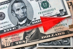 Growing Dollar. Red Arrow over American Dollars indicates Growth Stock Photos
