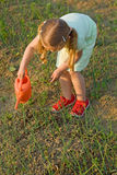 Growing food - little girl watering seedlings Royalty Free Stock Photos