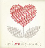 Growing heart on vintage paper Stock Photo
