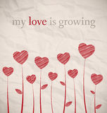 Growing hearts on crumpled paper Stock Photo