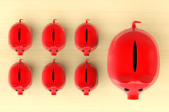 Growing investment concept. Red Piggy Banks in row Royalty Free Stock Photography