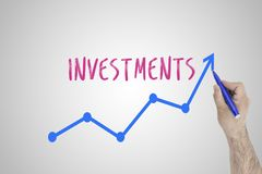 Growing investments concept on white board. Businessman draw accelerating line of improving investments against whiteboard. Stock Photos
