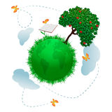 Growing knowledge. Green planet earth with tree and growing book as if it was a flower Royalty Free Stock Photography