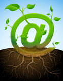 Growing mail symbol like plant with leaves and roo. Stylized plant in shape of at sign in ground. Qualitative vector (EPS-10) illustration about internet Stock Photos