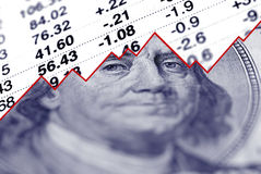 Growing Money. Closeup of hundred dollar bill with graph and stock chart in background Stock Image