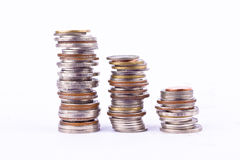 Growing money graph on a three row of coin and pile of bath coins stack on white background finance business isolated royalty free stock image