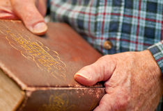 Growing Old With Faith. And older man holds a worn copy of the Bible Royalty Free Stock Photography