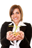 Growing plant and coins Stock Photos